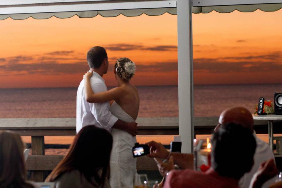 Beach wedding reception sunset