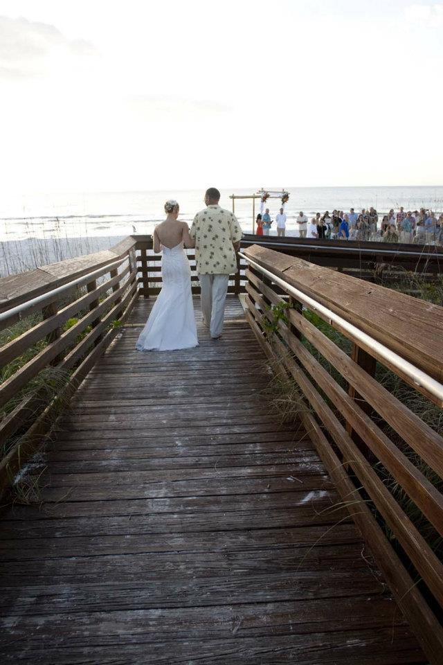 father walking daughter down the aisle beach wedding